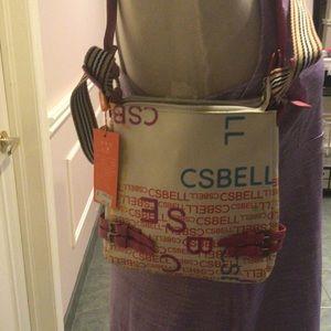 White purse with multicoloured print crossbody